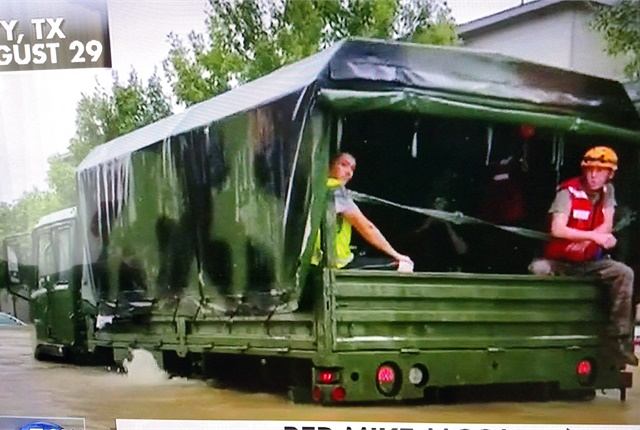 Military 5-ton 6x6 truck wades through deep water with evacuees. Image: Screen capture, Fox News