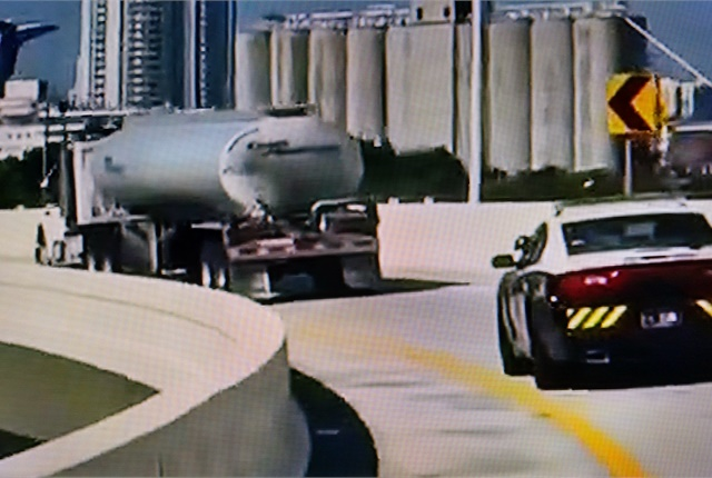 Gasoline tankers are getting police escorts, like this one in Miami. Florida's governor has asked surrounding states to ease weight and driving-hour restrictions for tankers. Screen capture from ABC News