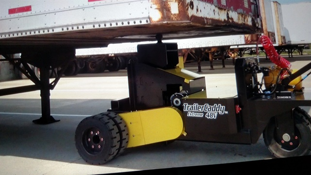 Compact walk-behind machine slips under a trailer's nose, lifts it, and pulls it away. Optional air system hooks up to brakes to release them. Photos: Screen capture from DJ Products video
