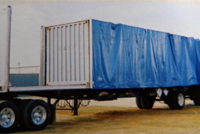 Rolling tarps retract either forward or aft to allow a flatbed to be loaded normally. Then, when rolled back and locked, the cargo is protected as though it were in a van. Photos: Tom Berg