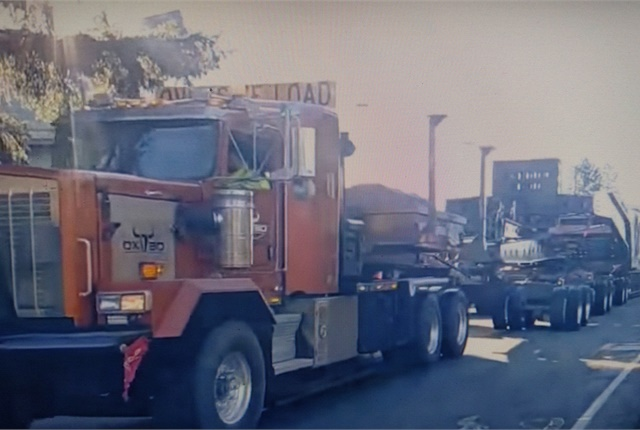 Lead prime mover was a Kenworth C500. A T800 pushed at the back of the load. Screen capturefrom YouTube.com, Puget Sound Rail Productions.