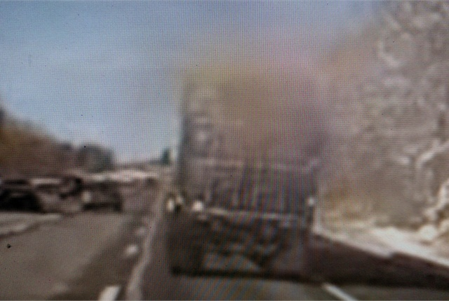 Snow blows off the roof of this semi (a container, actually), which can be dangerous and is illegal in some states. Screen capture from YouTube