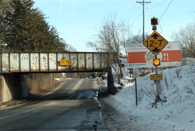 "Numerous signs on West Central Avenue (SR 37) in Delaware warn of this 12' 7"" overpass, and there's a posted truck route that avoids it. Yet it's been hit many times over the years."