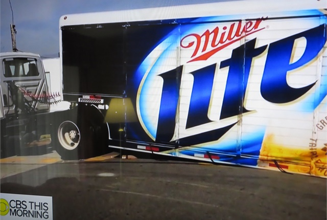 This low-slung beverage trailer barely scraped its way over the apex. Driver was probably using this route to bypass traffic backup on a more sane set of streets.