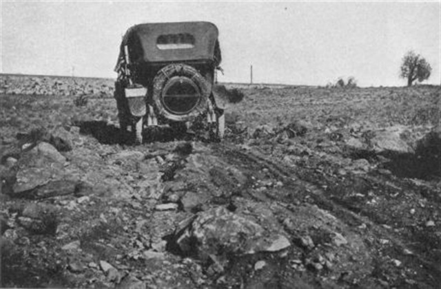 Rutted dirt was the rule on rural roads, like this one in Arizona. Rains made them muddy quagmires. Tall wheels with narrow tires worked well in these conditions. Photos: America on the Move