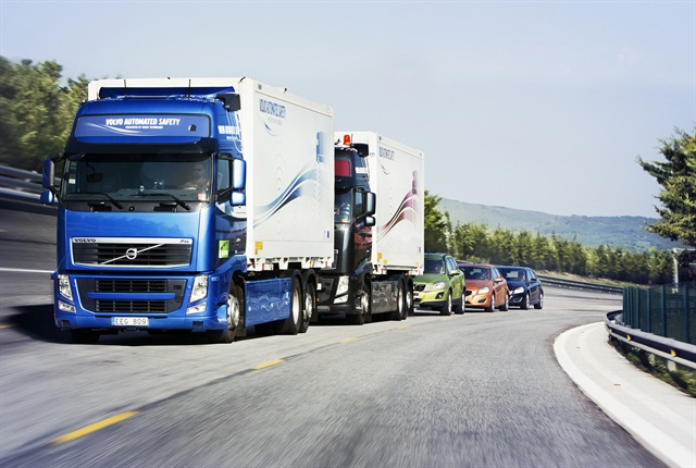 "In the Sartre project, three self-driving Volvo cars ""platoon"" behind a commercial truck."