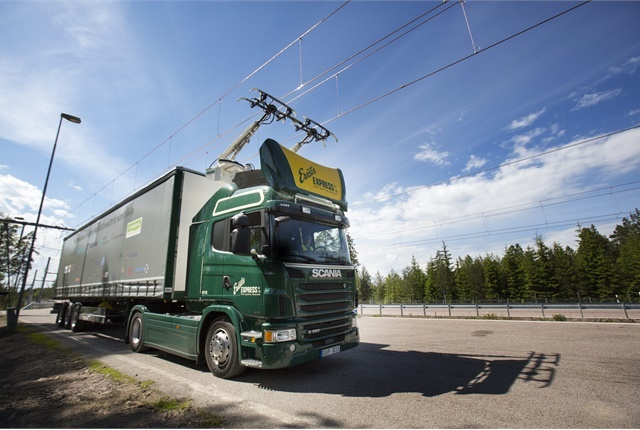Dedicated lanes for electric trucks, with overhead electric cables to supply power, will likely be a common fixture in a modern 21st Century highway network. Photo: Scania