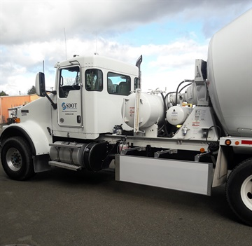 Seattle DOT's concrete mixer truck has a Walker Blocker side guard to close the gap ahead of the rear tandem's wheels.