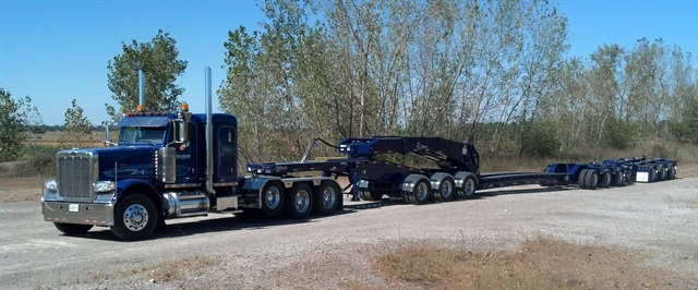 """Trailer includes a 3-axle """"jeep"""" dolly, 3-axle lowboy and 3 flip-down axles. Axles can be removed for lighter-weight loads."""