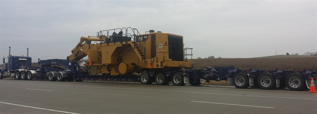 Cat 992G loader's wheels and bucket had to come off, but otherwise it went as a 150,000-pound load.