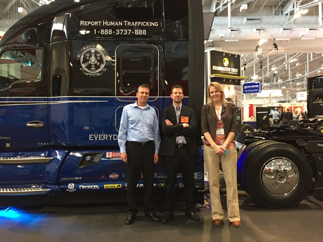 """Inland Kenworth will auction off a special KW T680 """"Everyday Heroes"""" truck in June and donate the proceeds to Truckers Against Trafficking. Here the truck is on display at FlowBelow's booth at the Technology & Maintenance Council annual meeting earlier this year. Photo: Deborah Lockridge"""