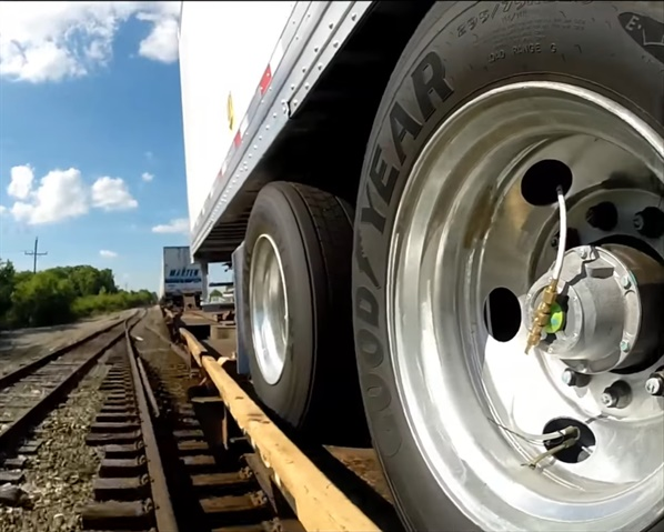 Aluminum wheels are shiny and new, and pressure inflation systems keep the fresh tires firm.