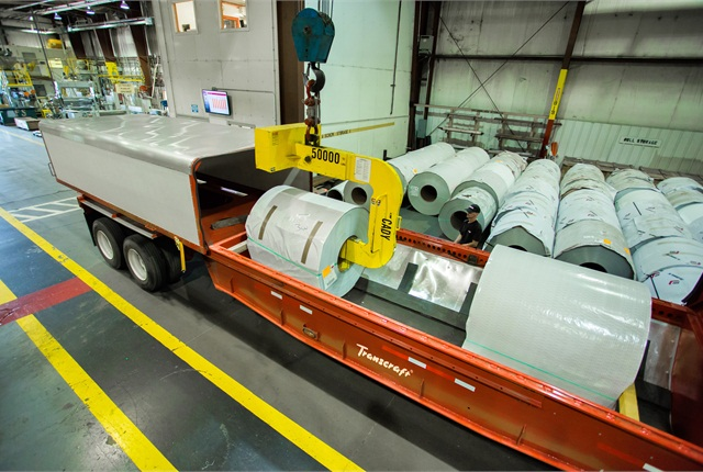 Rubber-lined well accommodates big, heavy metal coils, which are usually strapped down. Sliding shelter covers the load.