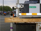 Alley-docking a 53-foot trailer without  bumping  the dock takes skill