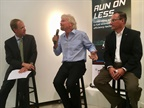 "Richard Branson (center) expounds on how trucking's mpg efforts are a ""ray of hope"" in the global campaign to save fuel and protect the planet from climate change. Looking on (right) is NACFE's Mike Roeth. Photo: David Cullen"