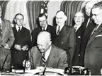 President Eisenhower signs the Federal Aid Highway Act into law on