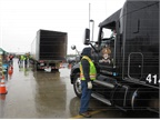 Rigs line up for a trailer inspection before proceeding to loading