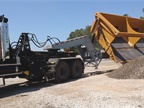 Off-road side-dump trailer offloads more than 50 cubic yards of
