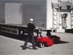 This operator moves briskly as he backs a trailer into a parking slot.