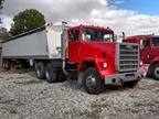 Wilson grain trailer and AM General M-915, an ex-Army  linehaul