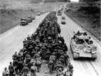 German POWs march to the rear while U.S. Army forces advance in both lanes on the German Autobahn in this iconic 1945 photograph. Photo: U.S. Army
