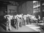 In 1937, longshoremen at ports in New York transfer bananas from a