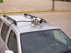 OWL magnet-mounts on the roof of a pilot car and is plugged into a laptop with an operating program. It knows how far from the road it is, and includes that in its vertical obstacle measurements. Photo: LSA Autonomy