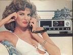 A then-unknown Rene Russo doing her best to make CB base stations