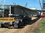 "Rear of load is supported by a ""steer car"" and"