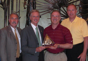 From left to right, Steve Robinson and Tim Musgrave from PSI, and Dick Giromini and Steve Miller from Wabash National.