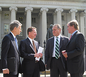 ATD representatives exit a meeting Wednesday with White House officials. L to R: Bert Hulgrave, ATD managing director; Kyle Treadway, ATD chairman; Dick Witcher; ATD vice chairman; and Phil Brady, NADA/ATD president.