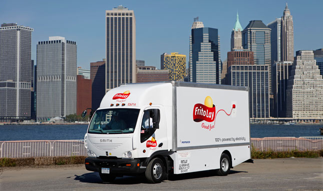 A Frito-Lay electric truck is seen with the New York city skyline in the background Tuesday, September 7, 2010. The truck is one of five all-electric trucks that Frito-Lay is rolling out in New York City. (David Goldman-AP Images for Frito-Lay)