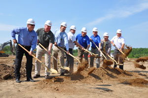 Members of JXT, JX Enterprises, the Village of Kronenwetter and members of Ghidorzi Companies (architects and construction firm for the new dealership) break ground for the new facility.