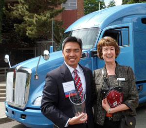 In front of the new Kenworth T680, from left, Reid Nabarrete, Kenworth assistant general manager for operations, and Jean Jacoby, associate dean of the College of Science and Engineering at Seattle University.
