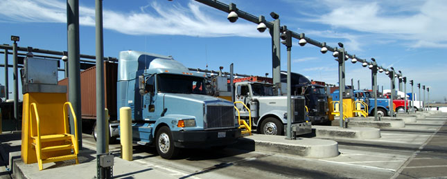 Trucks entering terminal gate at Port of Los Angeles. No owner-operator will be allowed by t he end of 2013.