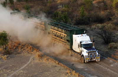 Mack Trucks was the number one exporter of heavy-duty North American trucks in 2009. Here, a powerful Mack pulls a stout load down a dusty road in Australia.