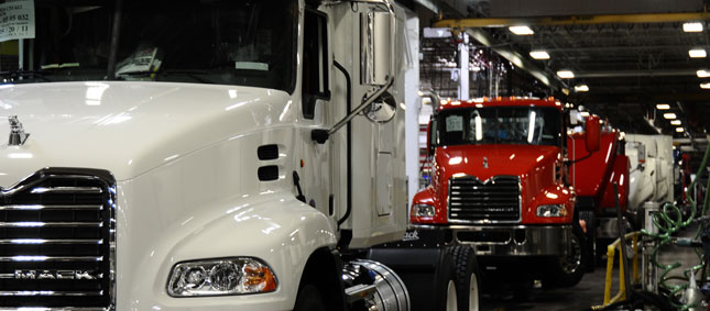 Mack says it has not had to cut production as some truck makers have.