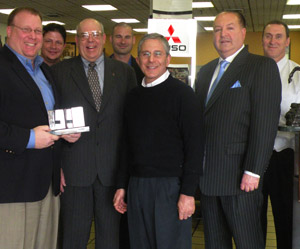 Mitsubishi Fuso executives present Milea Truck Sales Corp. with the Dealer of the Year Award.