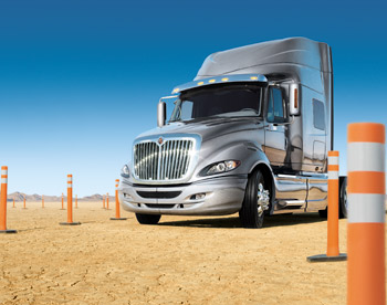 Navistar's new truck models, acquisitions and overseas partnerships are boosting revenues and giving the company a big global footprint, executives say.