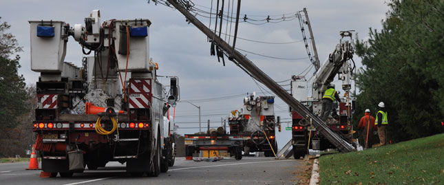 Utility trucks work to get power back up in New Jersey following Hurricane Sandy.