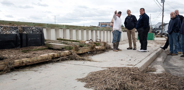 President Barack Obama and New Jersey Gov. Chris Christie talk with citizens who are recovering from Hurricane Sandy, while surveying storm damage in Brigantine, N.J. (Official White House Photo by Pete Souza)