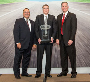 Left to right: Robert Woodall, Peterbilt director of sales and marketing; Eddy Stahl, Jr., Dealer Principal and President; Bill Kozek, Peterbilt General Manager and PACCAR Vice President