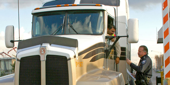 An official at the Port of Tacoma checks a driver's TWIC card.