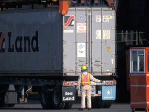 Here, a container is loaded onto a truck at the Port of Tacoma. (Photo courtesy of Port of Tacoma)
