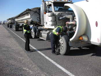 Testing equipment is installed on the truck's brake system to measure air-brake lag time. Photo by NTSB.