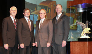 From left are Gary Moore, Kenworth general manager and Paccar vice president; Edmonton Kenworth executives Collin Ferguson and Gary M. King; and Preston Feight, Kenworth assistant general manager - marketing and sales.