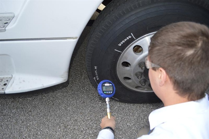 A Goodyear Tire & Rubber Company tire test engineer checks the