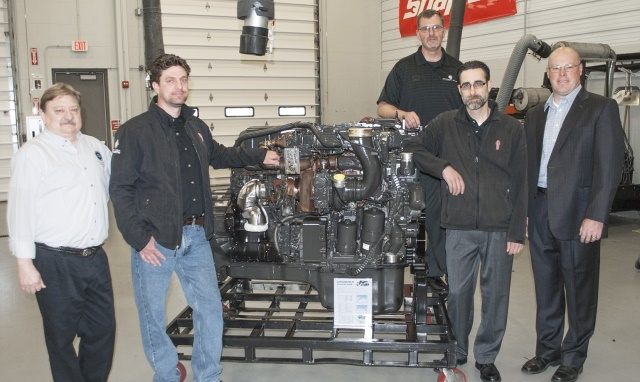 Presenting the donated engine from Berger Dealer Group are service