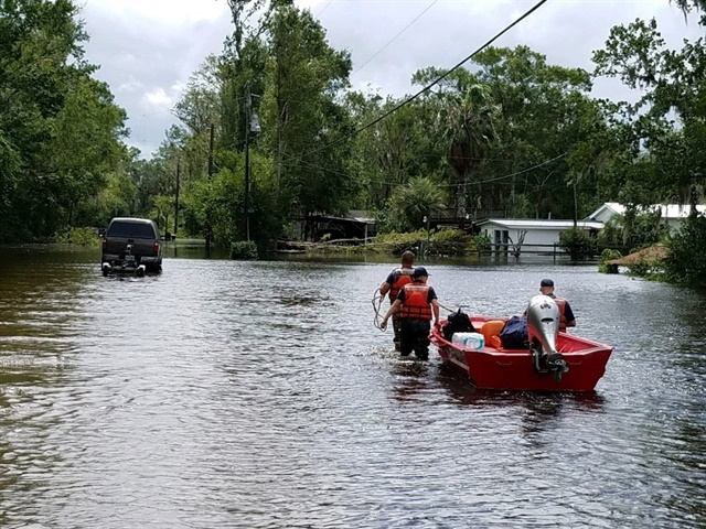 Coast Guard Flood Punt Teams conduct rescue operations in
