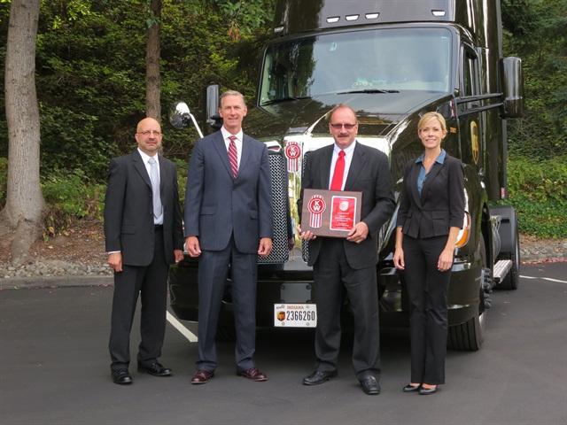 From left, Ray Lehrman, automotive supervisor for UPS; Preston Feight,